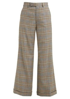 Gucci Flared jacquard-check wool trousers