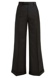 Gucci Flared wool-blend trousers