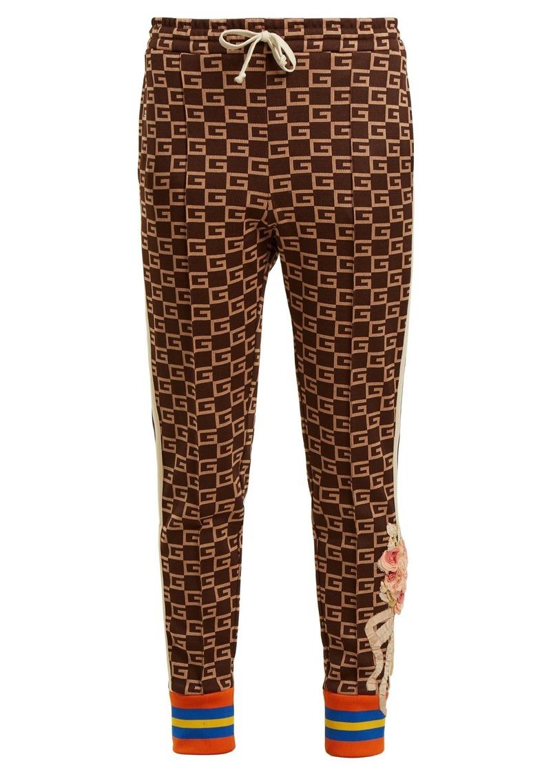 b419befa9ec Gucci Gucci GG-jacquard mid-rise jersey trousers