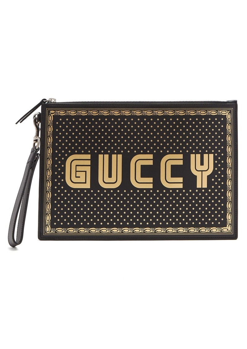 a12cdc81212343 Gucci Gucci Logo and star-print leather pouch | Bags