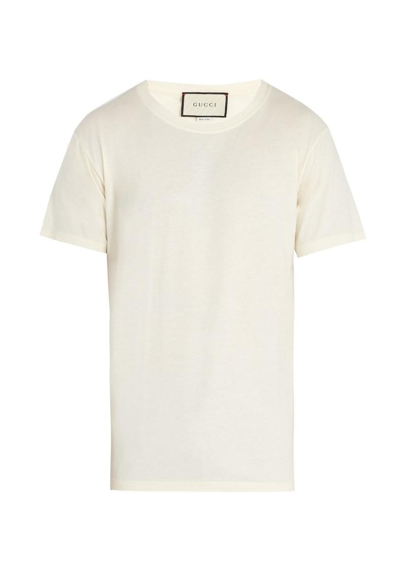 c35a9fe320f Gucci Gucci Logo-print distressed cotton T-shirt