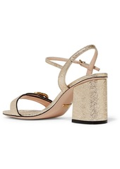 c8e8fdbc8fa ... Gucci Marmont logo-embellished metallic cracked-leather sandals ...