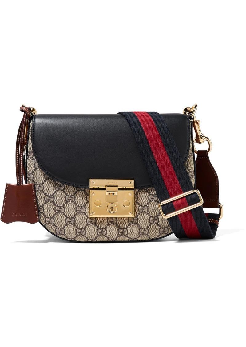ca85afd4a Gucci Padlock Saddle medium leather-trimmed coated-canvas shoulder bag
