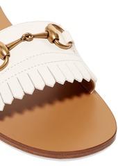 2a3131b02d8 Gucci Varadero horsebit-detailed fringed leather slides