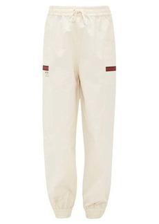Gucci Web-striped cotton-canvas track pants