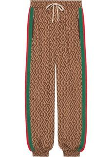 Gucci monogram print track pants