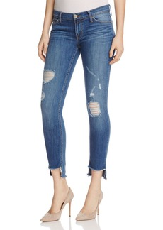 Hudson Distressed Step-Hem Skinny Jeans in Hustle