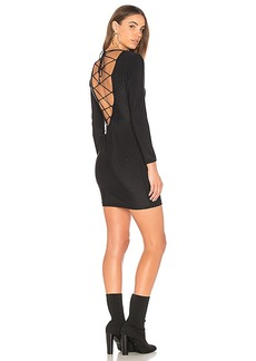 Indah Addiction Mini Dress in Black. - size L (also in M,S,XS)
