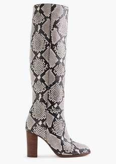 High-heel knee boots in snakeskin-printed leather