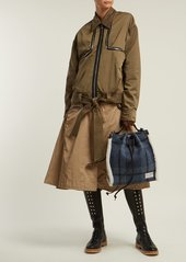 ce6060f45877 ... JW Anderson Drawstring shearling-trim Harris tweed bucket bag ...