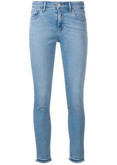 Levi's frayed hem skinny jeans