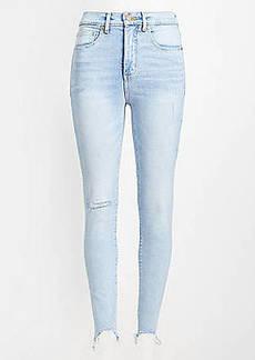 LOFT High Rise Chewed Hem Skinny Jeans in Classic Light Indigo Wash
