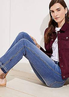 LOFT Petite Modern Slit Unpicked Straight Leg Jeans in Mended Mid Indigo Wash
