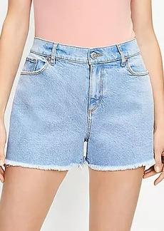 LOFT Petite Curvy Distressed High Rise Cut Off Denim Shorts in Original Mid Indigo Wash