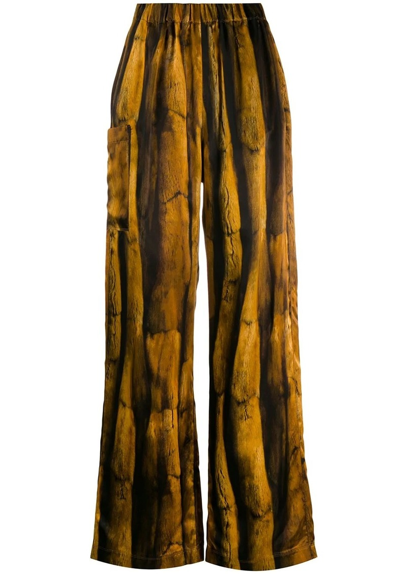 Maison Margiela fur-print flared trousers