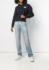 Maison Margiela low rise paint effect jeans