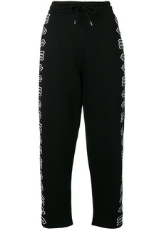 McQ Alexander McQueen cropped repeat logo track pants