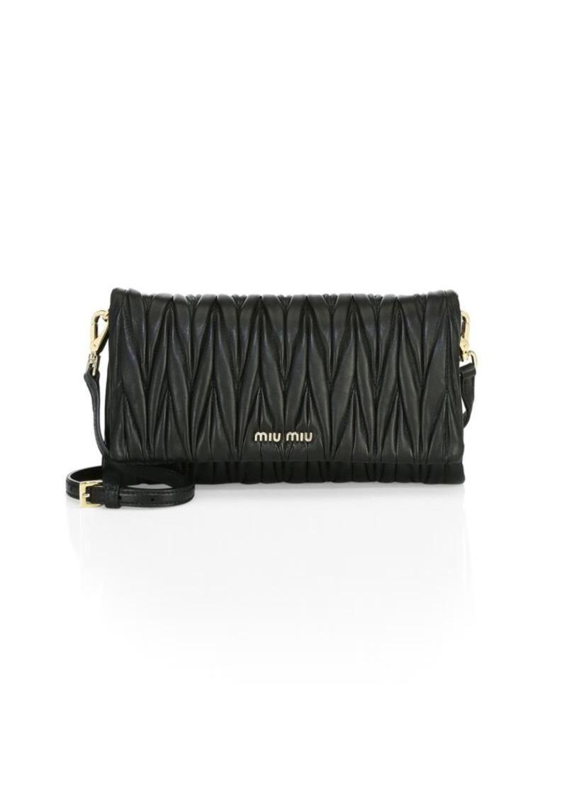 5501078fe97 Miu Miu Matelasse Bandoliera Clutch   Handbags
