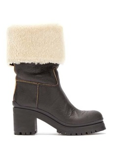 Miu Miu Leather and shearling boots