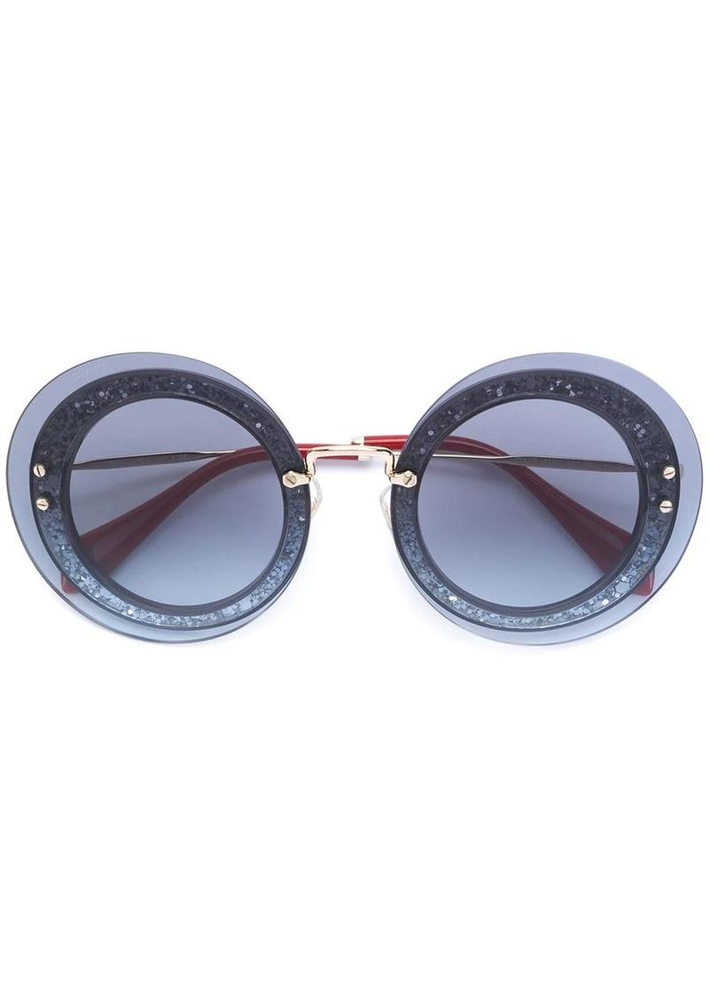 Miu Miu Reveal ti sunglasses