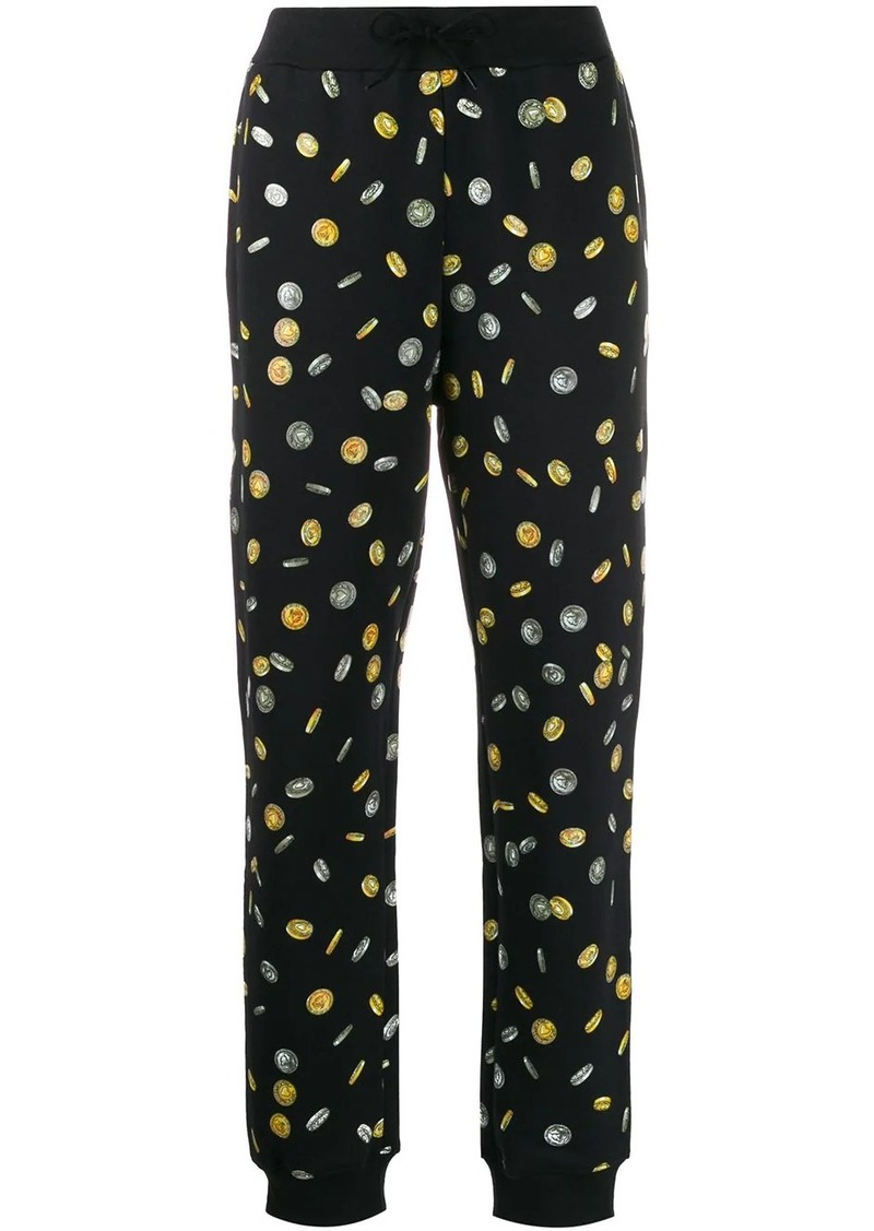 Moschino coin print track trousers