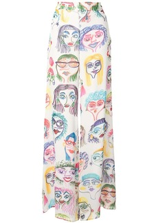 Moschino faces print georgette trousers
