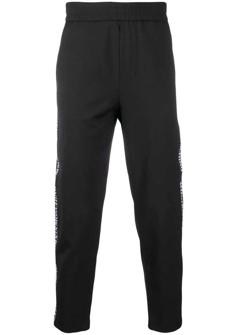 Moschino logo trim track pants