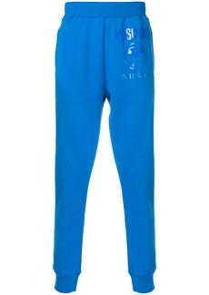Moschino tonal printed track trousers - Blue