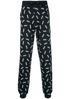 Moschino multiple logo track pants