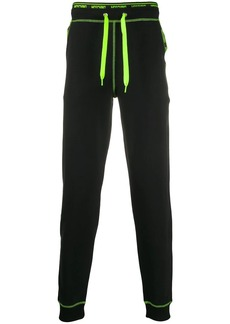 Moschino neon logo taped track pants