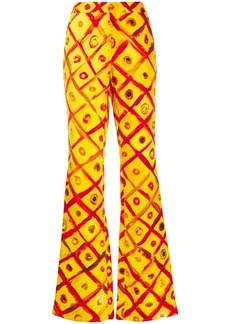 Moschino painted check print trousers