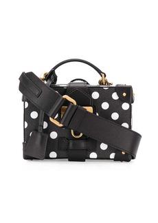 Moschino polka dot luggage bag