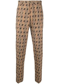 Moschino Prince of Wales numerical print trousers