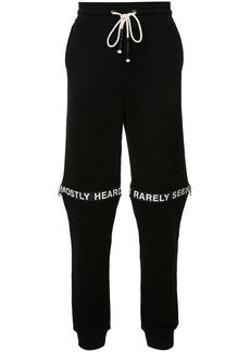 Mostly Heard Rarely Seen logo track pants