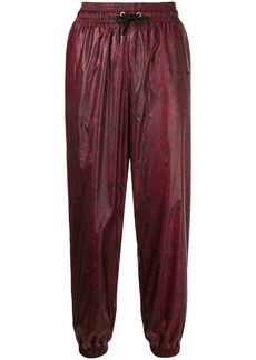 Nike relaxed-fit snakeskin-print trousers