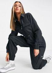 Nike Swoosh utility jumpsuit in black