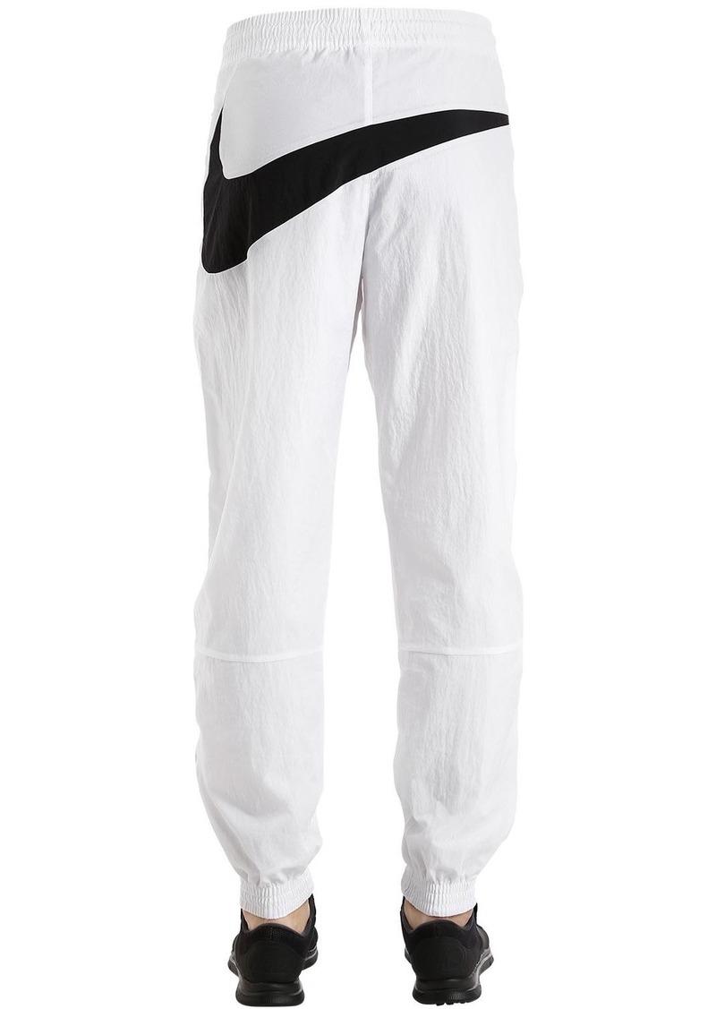 new style 2ca67 2bb81 Nike Vaporwave Swoosh Woven Track Pants