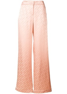 Off-White monogram print trousers