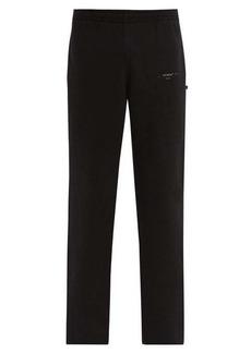 Off-White Partial stripe-print cotton-jersey track pants