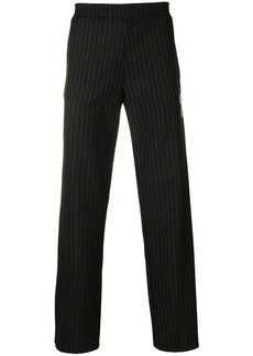 Off-White pinstriped eagle stripe trousers