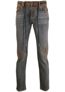 Off-White stain effect skinny-fit jeans