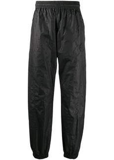 Off-White textured arrow track pants