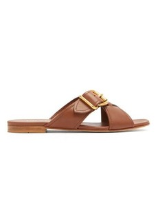 Prada Buckled cross-over leather slides