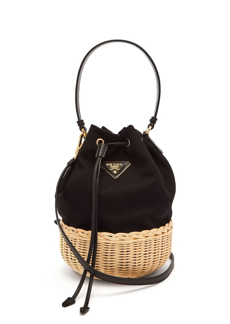 4b9f469f31cff8 Prada Prada Canvas and woven straw bucket bag | Handbags