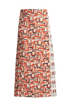 Prada Lipstick and U-print wrap skirt