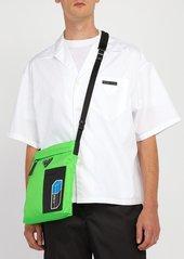 82cc55f669dc SALE! Prada Prada Logo-plaque nylon cross-body bag
