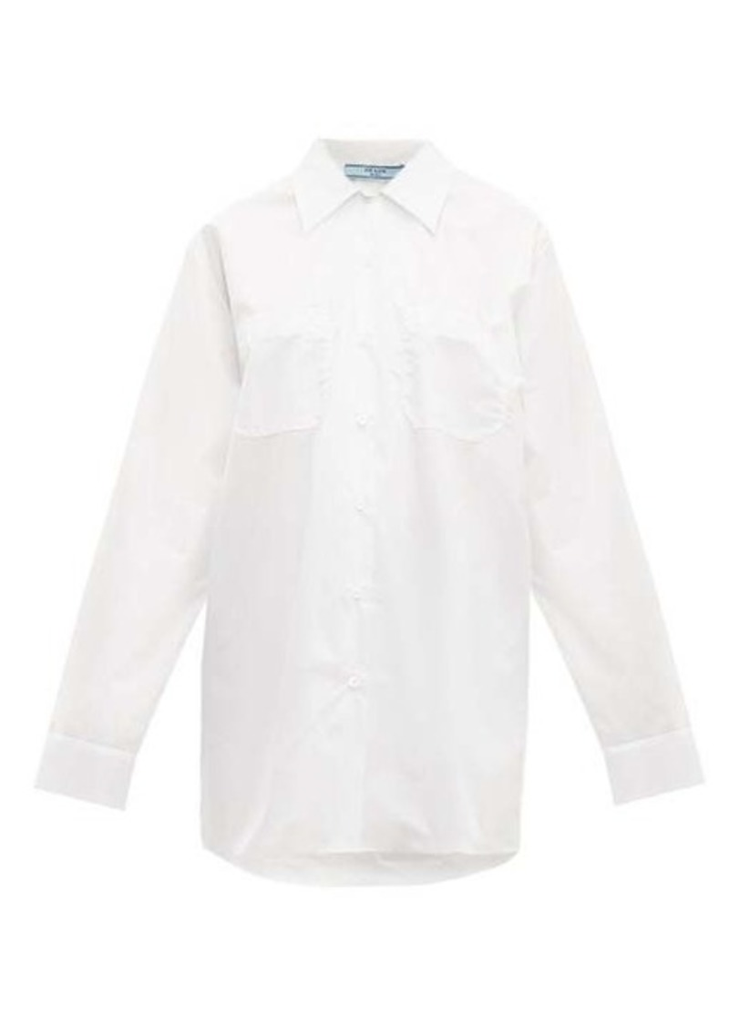 Prada Oversized bow-embellished cotton-poplin shirt