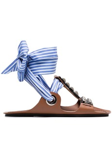 Prada Brown gladiator sandals with studs and black ribbon and a blue