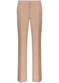 Prada slim leg buttoned cuff tailored woollen trousers