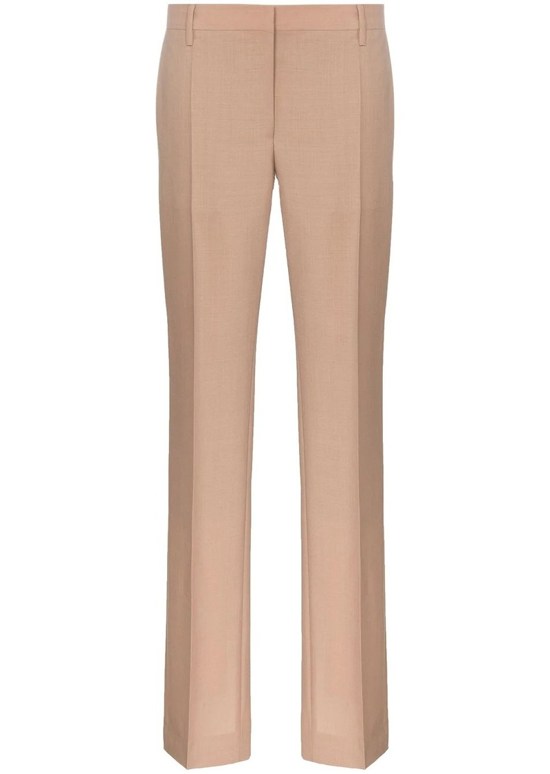 Prada slim leg buttoned cuff tailored woollen trousers